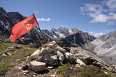 Red USSR flag at the top of mountain among stones — Stock Photo