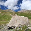 Rocks in valley,Caucasus mountains.Blue sky,clouds - Foto de Stock