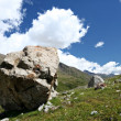 Rocks in valley,Caucasus mountains.Blue sky,clouds — Stock Photo