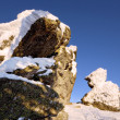 Snow-covered rocks against blue sky.Siberia.Taiga. — Stock Photo