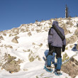 Climber in snowshoes (snow shoes) walking at the mountain slope. Russia. Ur — Stock Photo