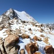 Foto Stock: Caucasus mountains. Elbrus area. Kabardino-Balkaria. Rocks in snow