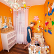 Stock Photo: Mother with child in a Baby Room