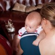 Mother Holding Baby in Living Room — Stock Photo #4122509