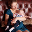 Mother with Her Baby on Sofa — Stock Photo #4122538