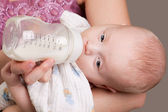 Baby Girl Drinking Milk — Stock Photo
