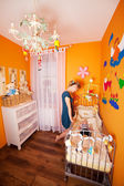 Mother with child in a Baby Room — Stock Photo