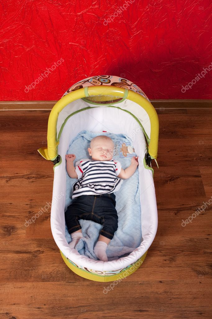 Two months old cute baby girl sleeping comfortably in a stroller in the living room — Stock Photo #4122380