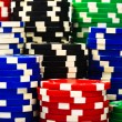 Stacks of poker chips  on a white background — Stockfoto