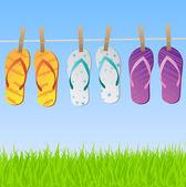 Sandalias en la línea de ropa — Vector de stock