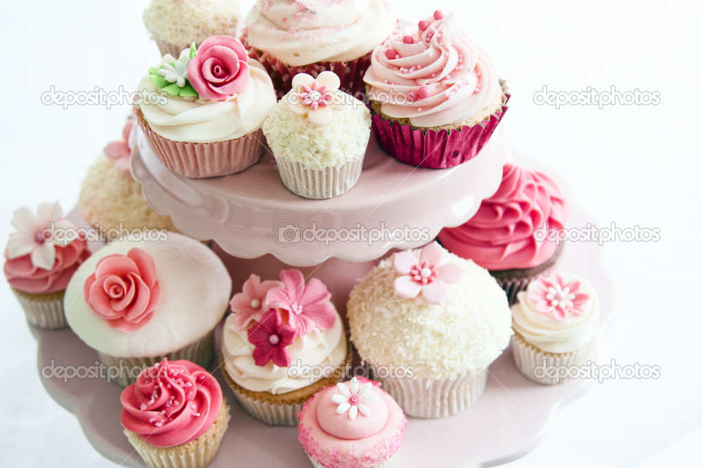 Array of cupcakes on a dessert stand  Stock Photo #5277705