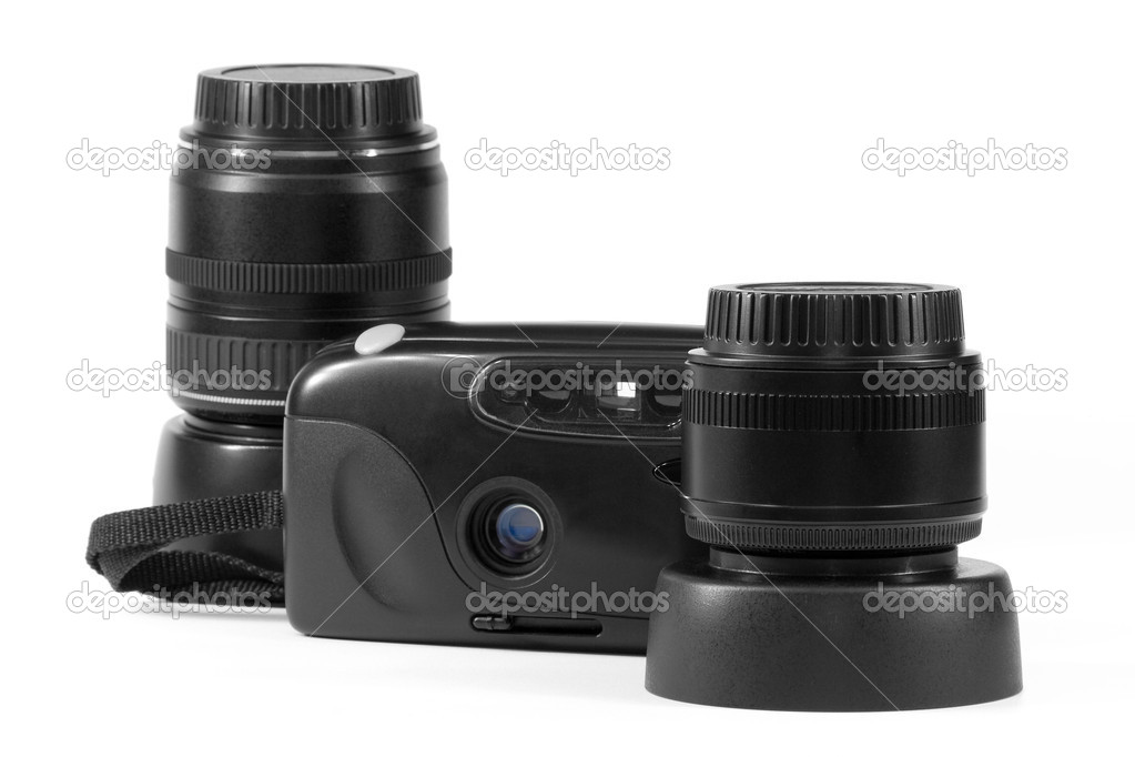 Modern new lenses and an old film camera — Stock Photo #3964172