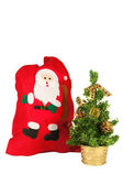 New Year's bag of gifts and Christmas tree — Stock Photo