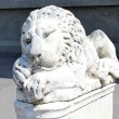 Lion statue sits majesticaly on it's pedestal - Stock Photo