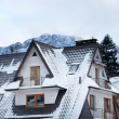 house in the snow with mountain as backgroud — Stock Photo