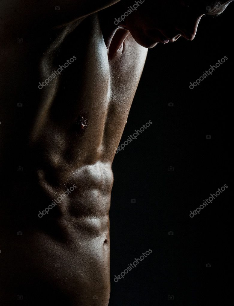 A male bodybuilder flexing his muscles — Stock Photo #4546563