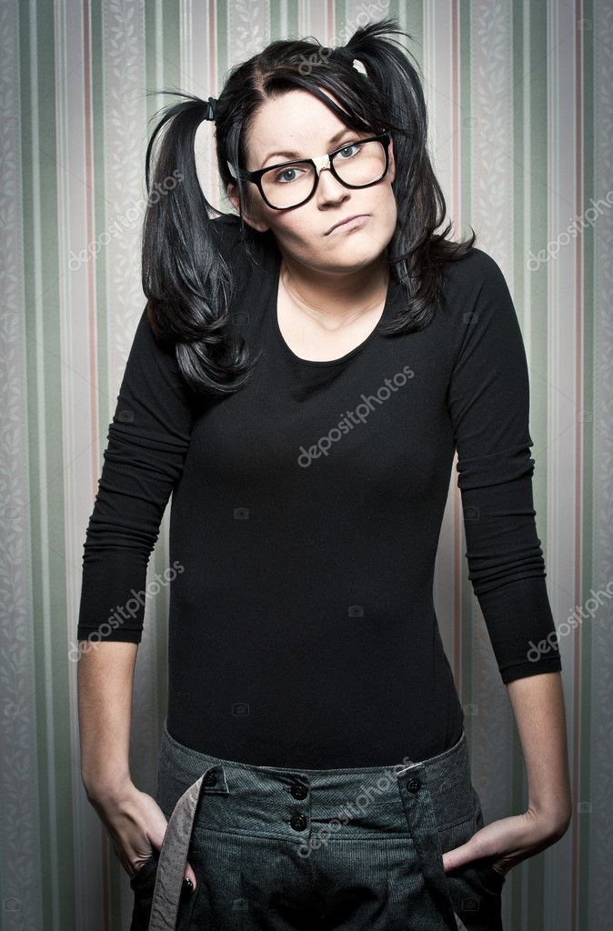 A young nerd girl with ponytails and large glasses — Stock Photo #5047112