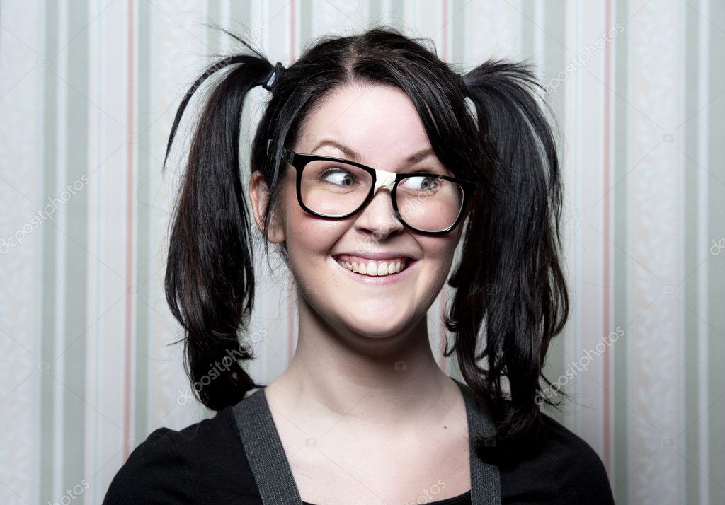 A young nerd girl with ponytails and large glasses — Foto Stock #5086143