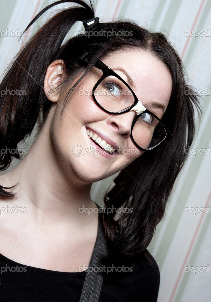 A young nerd girl with ponytails and large glasses — Stock Photo #5305581