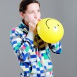 Girl inflating a balloon — Stock Photo #4529679