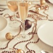 Beautiful gold place setting for Christmas - Stock Photo