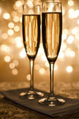 Champagne in the glass on the background bokeh — Stok fotoğraf