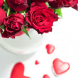 Roses and red hearts — Stock Photo