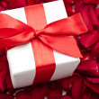 Royalty-Free Stock Photo: White Gift box with red ribbon