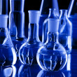Laboratory Glassware in blue - Stock Photo