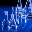 Laboratory Glassware in blue - Foto Stock