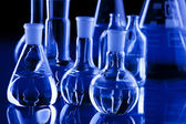 Laboratory Glassware in blue — Stok fotoğraf