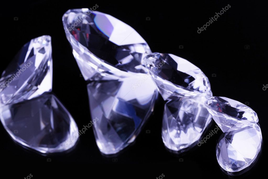 Diamonds, jewels on mirrored background  Stock Photo #4660482