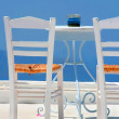White chairs in Santorini — Stock Photo
