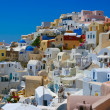 Stock Photo: Colourful Oia village panorama