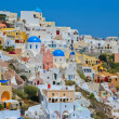 图库照片: Colourful Oia village panorama