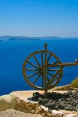 Wooden wheel in Santorini — Stock Photo