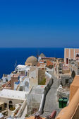 Beautiful view on Oia village and wind mill — Stock Photo