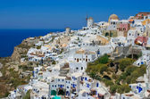 Traditional windmills in village Oia in Santorini, Greece — Stock Photo