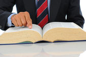 Businessman pointing at book — Stock Photo