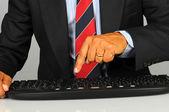 Businessman pressing key on keyboard — Stock Photo