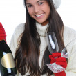 Young Woman with Champagne Bottle and Glasses — Stock Photo