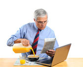 Middle Aged Man Pouring Milk into His Cereal Bowl — Stock Photo