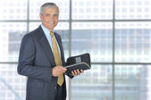 Standing Businessman with Planner Notebook — Foto Stock