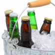 Closeup of a bucket of assorted beer bottles — Stock Photo