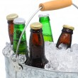 Closeup of a bucket of assorted beer bottles — Stock Photo #4767113