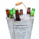 Assorted beer bottles in a bucket of ice — Stock Photo