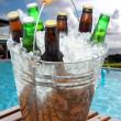Beer Bucket on Poolside Teak Table — Stock Photo