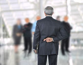 Standing Businessman with fingers crossed behind back — Stock Photo