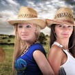 Two Girls Wearing cowboy Hats And Smiling — Stock fotografie #4275994