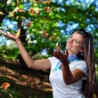 Autumn girl portrait outdoors and forest in the background - Stockfoto